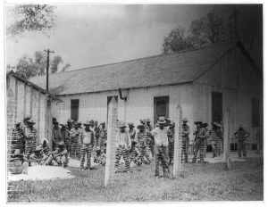 Angola_Prison_--_Leadbelly_in_the_foreground