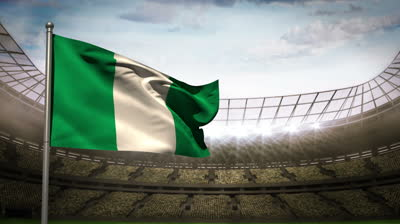 stock-footage-nigeria-flag-waving-on-flagpole-in-football-stadium-with-flashes