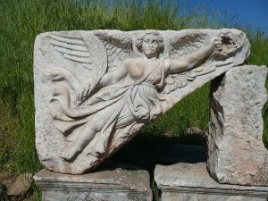 A stone carving of the Goddess Nike at the ruins of the ancient Greek city of Ephesus, Turkey