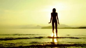 stock-footage-silhouette-of-a-woman-standing-on-the-shore-and-thinking-about-something