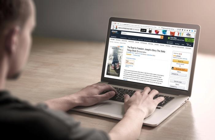 Man using/working on laptop computer