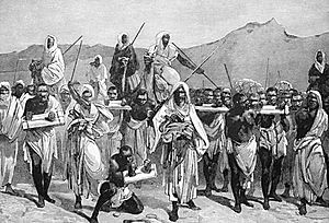 Engraving of Arab slave-trading caravan transporting African slaves across the Sahara.