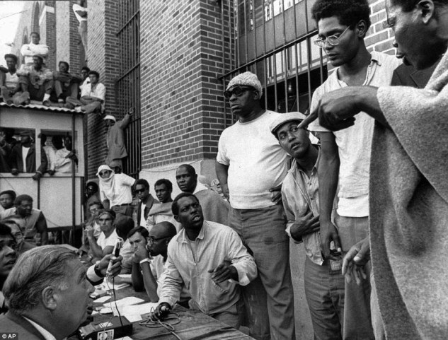 Inmates of Attica State Prison (right) negotiate with Commissioner Russell Oswald (lower left) inside the jail where prisoners took control